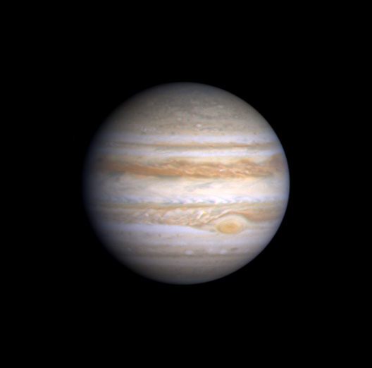 Image Jupiter – with cloud features like the Great Red Spot, Olivarez Blue Features, Belts and Bands. The black dot is the shadow of a moon.