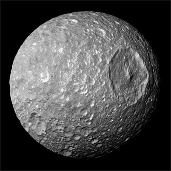 Image of Saturn's satellite Mimas, a gap moon with a moon-splitting crater, looking like the Death Star.