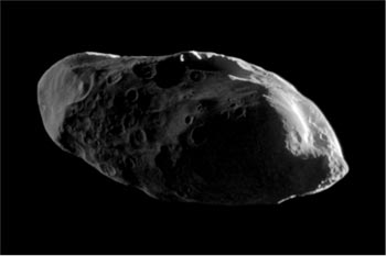Image of Saturn's satellite Prometheus, small and elongated in shape showing ridges and valleys.