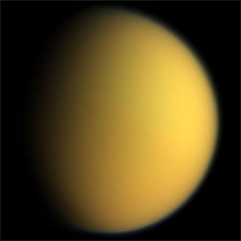 Image of Saturn's Satellite Titan showing its thick orange atmospheric haze.