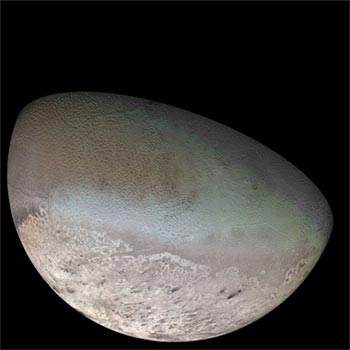 Image of Neptune's moon Triton shows cratered surface with mounds and round pits.