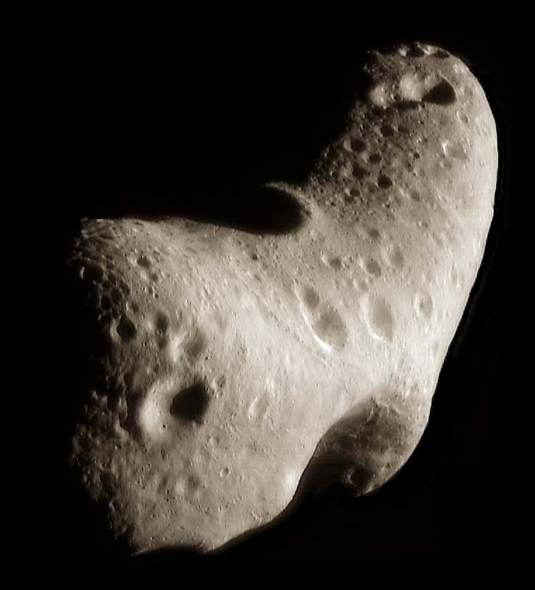 Image of Asteroid (433) Eros, which is irregular in shape and about 12 miles long.