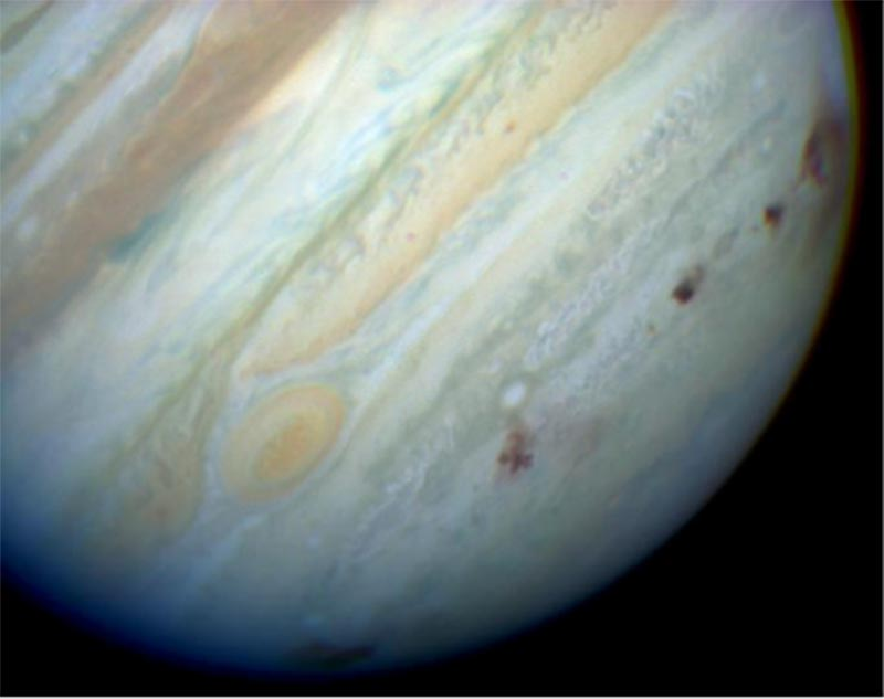 Image of Jupiter exhibiting some of the Shoemaker–Levy 9 fragment impact sites as black spots.