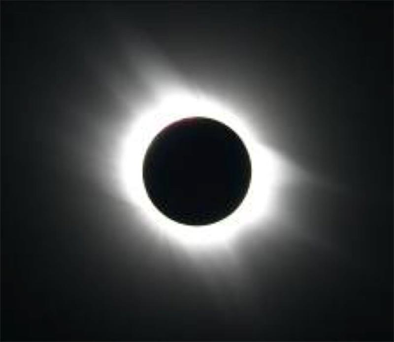 Black and white image showing the sun's bright outer atmosphere.