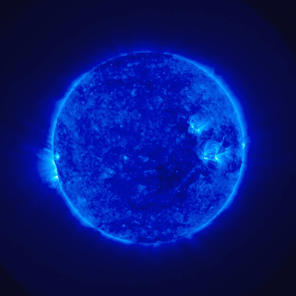 A spacecraft image of the Sun, taken in ultraviolet light, which shows various forms of solar activity.