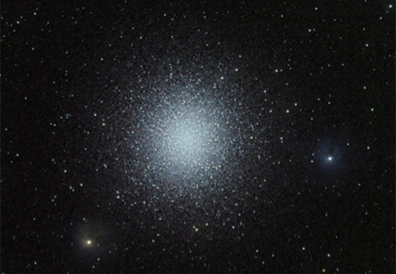 Globular Cluster in Hercules, M13; tight grouping of stars, spherical in shape.