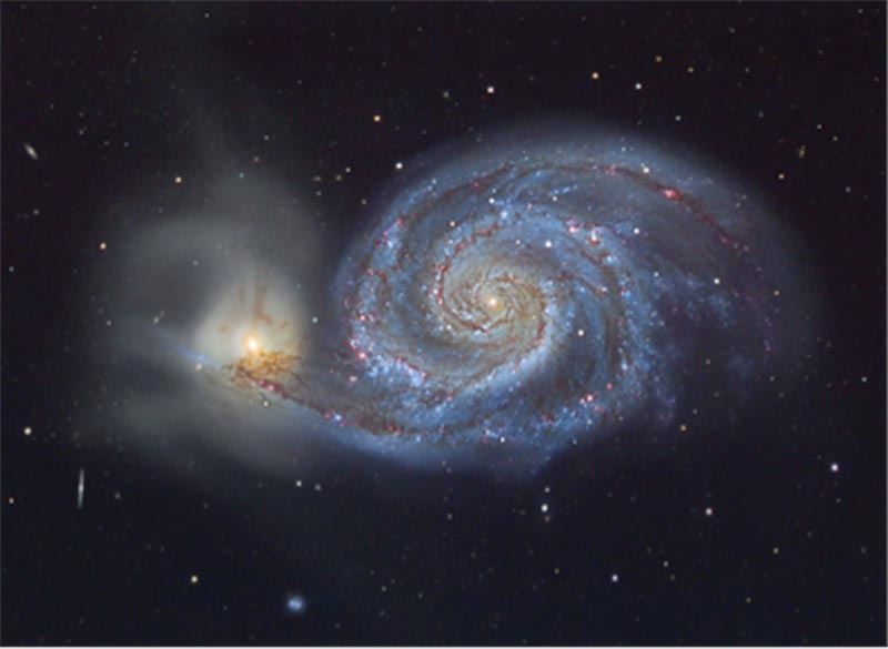 A photograph of the Whirlpool galaxy, a spiral galaxy.