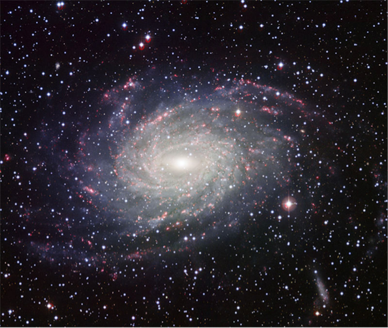This large barred spiral galaxy is believed to be similar in shape to the Milky Way Galaxy. Dust lanes, spiral arms, and a bar at the galaxy's center are visible.