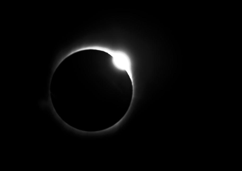 A total solar eclipse which creates a diamond ring in the sky.