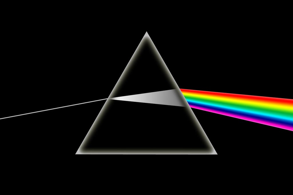 Image of light moving through a prism and creating a rainbow.