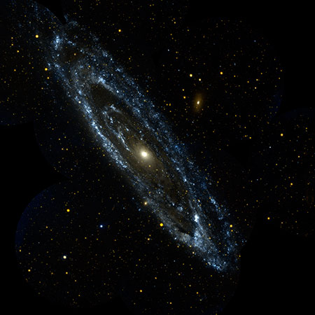 Image of Andromeda Galaxy in Visible Light. The wisps of blue making up the galaxy's spiral arms are neighborhoods that harbor hot, young, massive stars. Meanwhile, the central orange-white ball reveals a congregation of cooler, old stars that formed long ago.