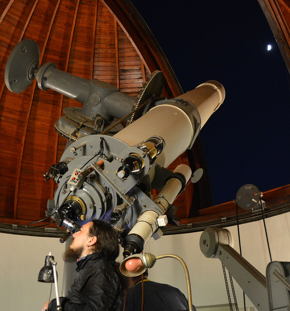 Image of a telescope inside an observatory.