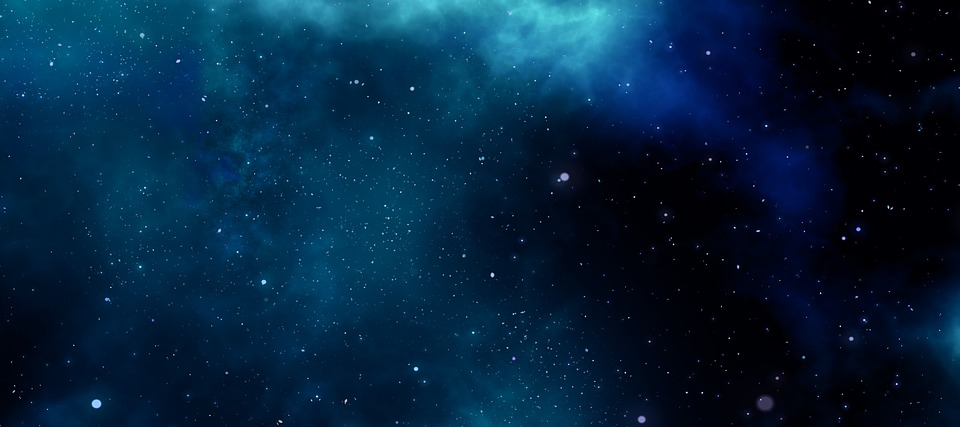 Image of a universe with vast amounts of stars and planets.