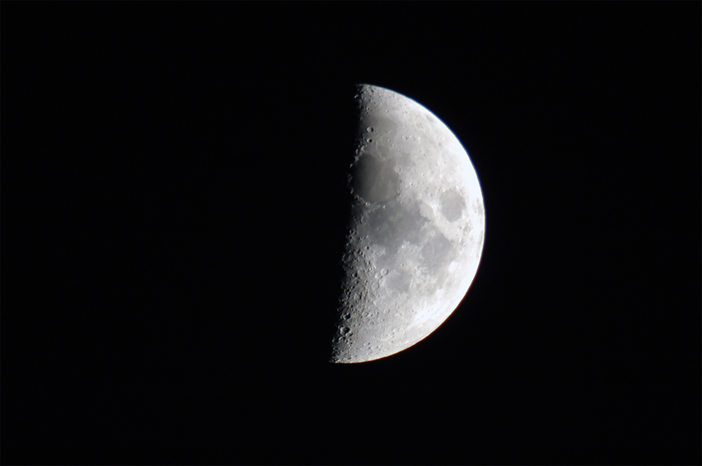 Image of a first quarter moon.