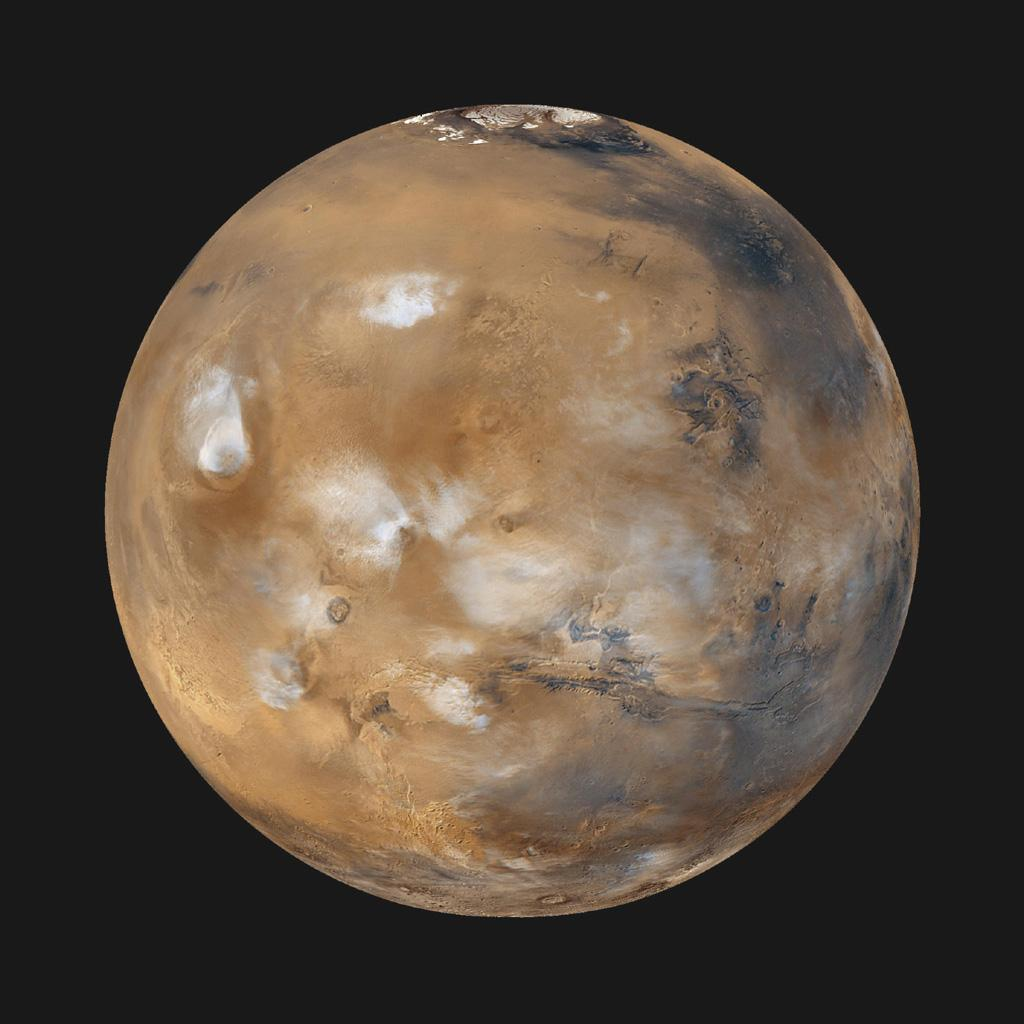 Image of Mars – note the polar cap (top), clouds.