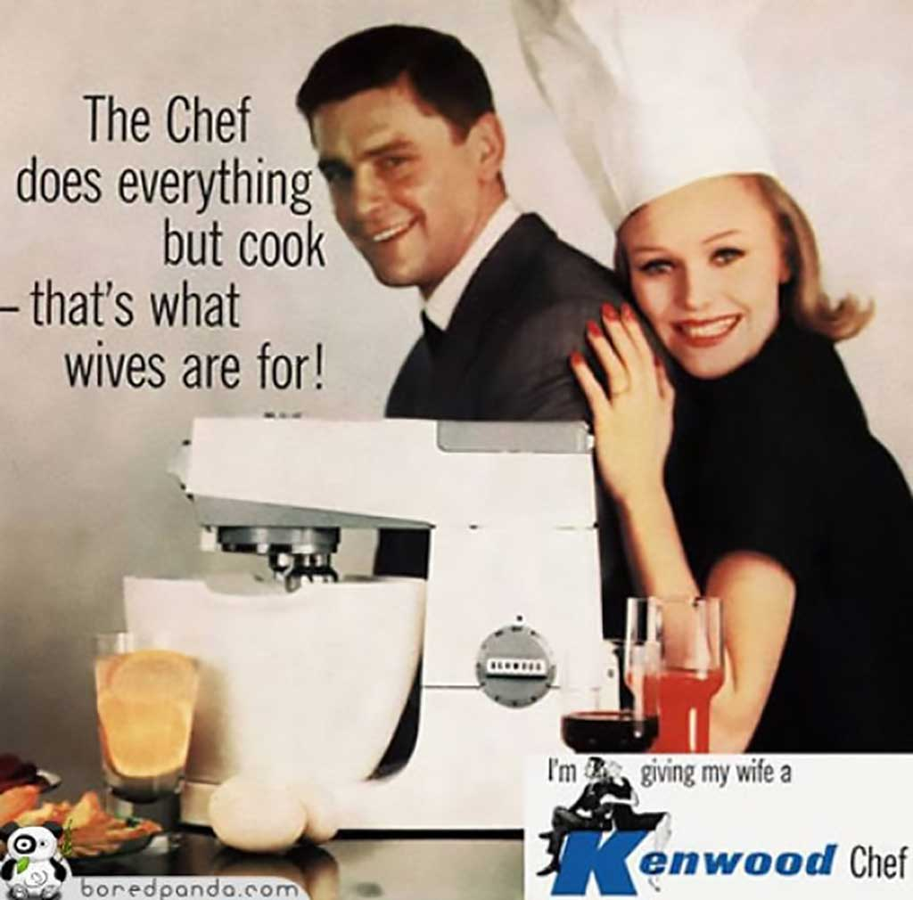 A print advertisement for a Kenwood electrical kitchen mixer. The image features a man in a business suit with a woman—ostensibly his wife—embracing him from behind. They are posing behind a white kitchen mixer and some assorted food items. She is wearing a chef's hat and is beaming at the camera. The advertisement includes text that reads 'The Chef does everything but cook—that's what wives are for!' In the lower right-hand corner of the advertisement, the text reads 'I'm giving my wife a Kenwood Chef.'