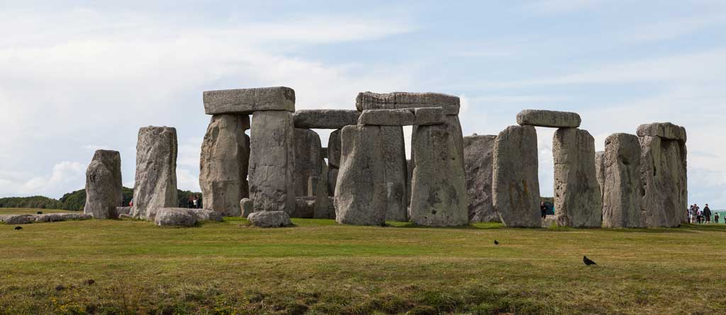 Picture of Stonehenge. The perspective captures how the heavy stones comprising the structure have been remarkably positioned to form a post-and-lintel layout.