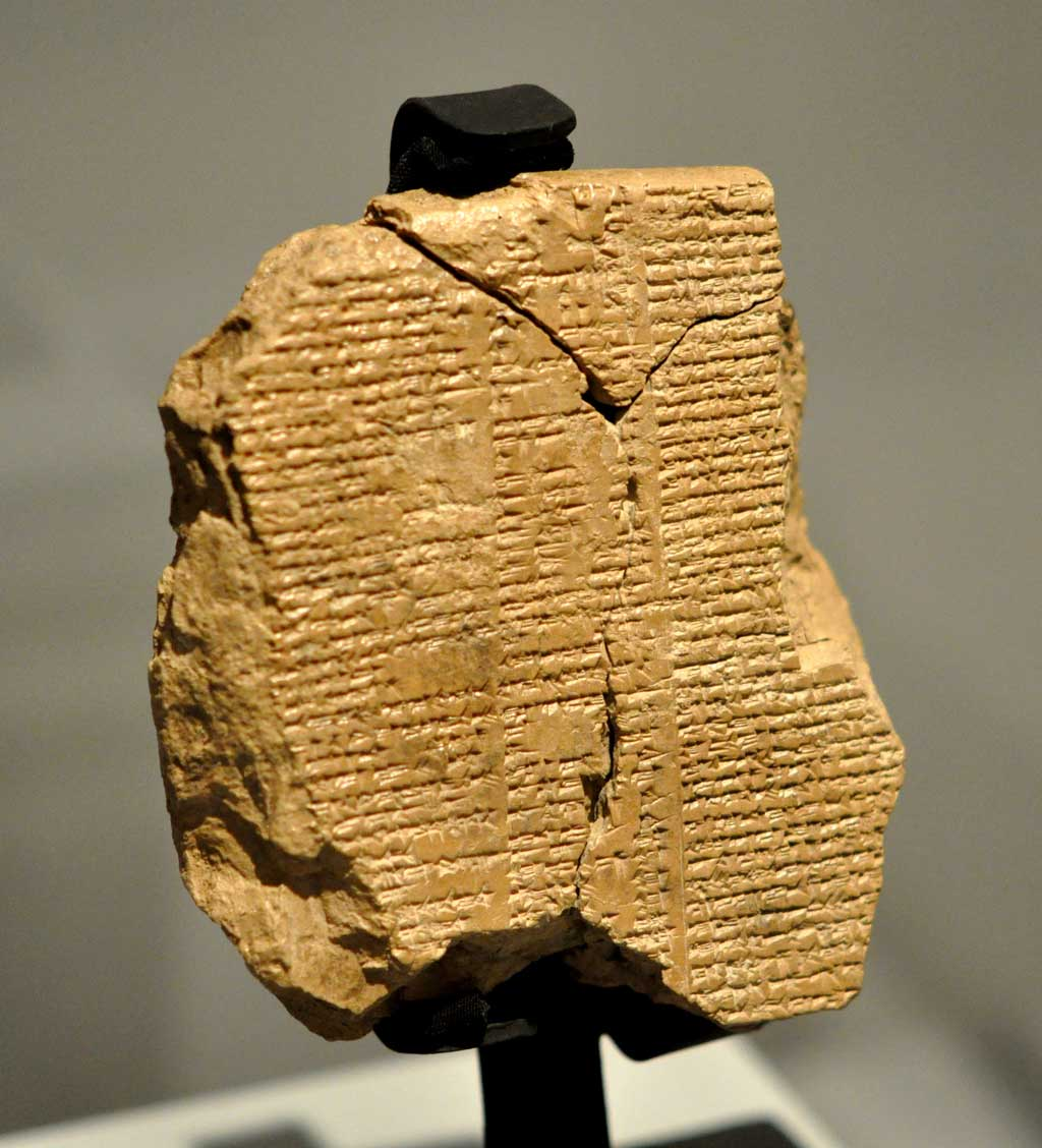 Brown textual fragment with the story of the Epic of Gilgamesh in cuneiform script.