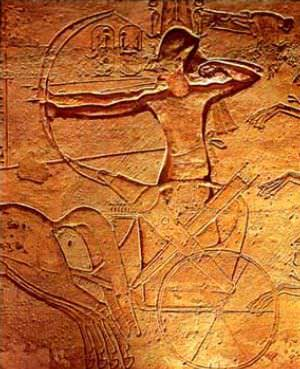 The stele depicts a two-dimensional Ramses in his horse-drawn chariot, firing a long bow in combat.