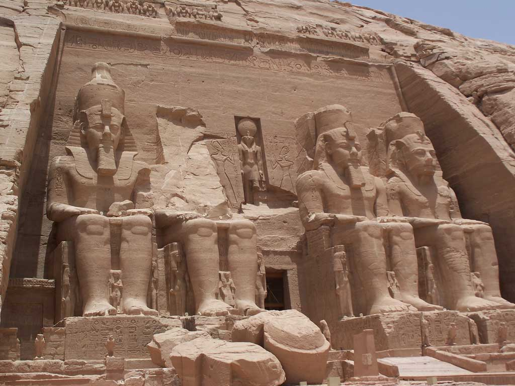 The picture is that of the entrance to Ramses' temple complex, Abu Simble. Here four massive stone depictions of a seated Ramses guard the entrance to the temple. Standing near his feet but much smaller in his size, is his wife Nefertari along with their children.