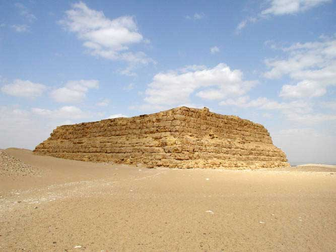 Remains of a real mastaba, standing alone in the desert.