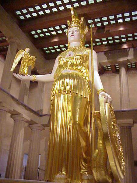 Picture of the statue of Athena found at Vanderbilt University. The colossal statue is a replica of the one that may have been at the Parthenon. Adorned almost entirely in golden garments, this statue stands forty-two feet in length, holds a golden statue of the god Nike in her right hand and a golden shield in the other.