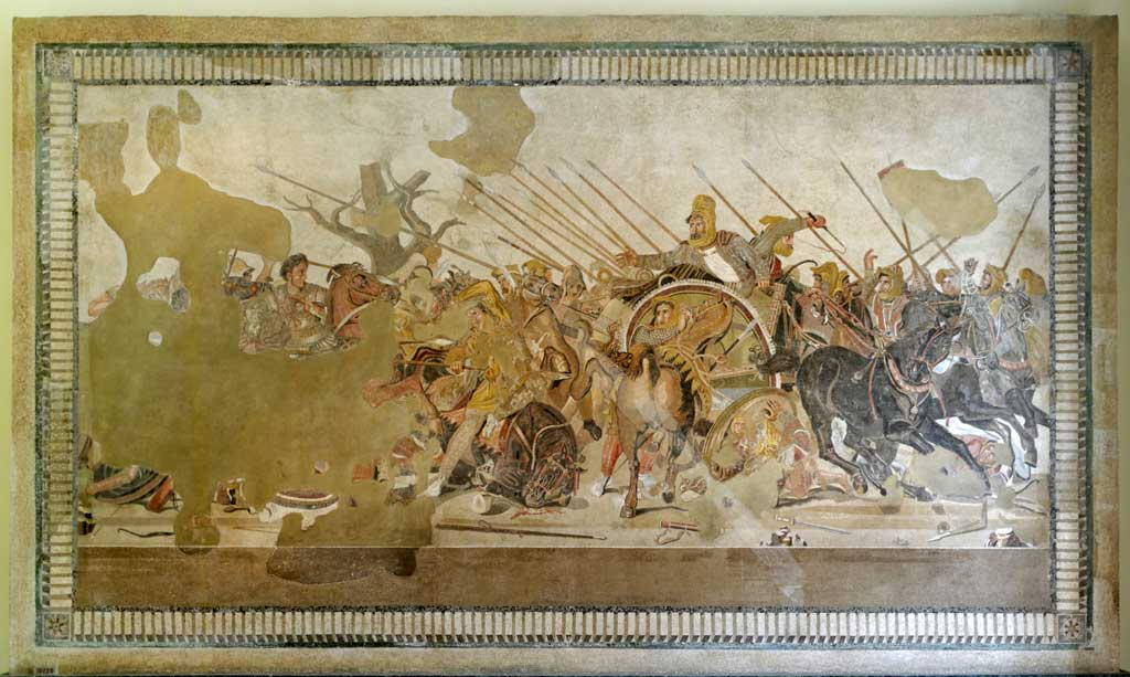 Mosaic of the Battle of Isus which depicts a dark-headed Alexander riding his brown horse Bucephalus, leading the charge against the retreating Persian king Darius.