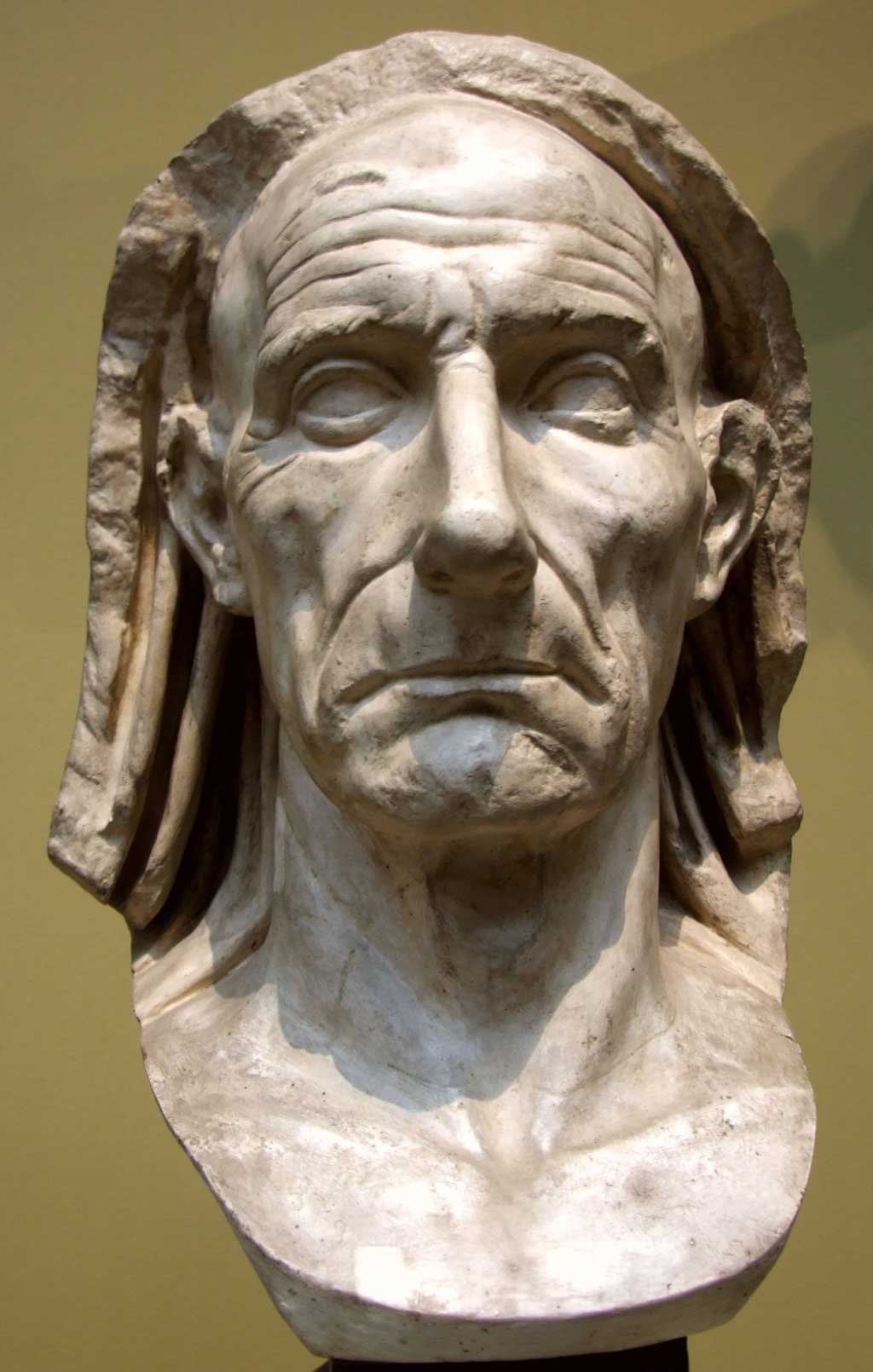 This photo shows the Bust of an Old Man. Verism refers to a hyper-realistic portrayal of the subject's facial characteristics, such as the wrinkles on this man's face.