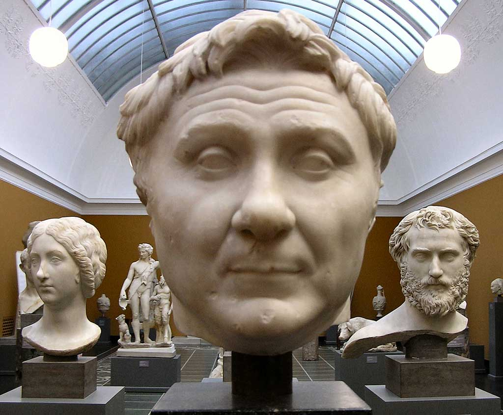 This photo shows a marble bust of Pompey the Great. Portraits of Pompey combine a degree of verism with an idealized hairstyle reminiscent of Alexander the Great.
