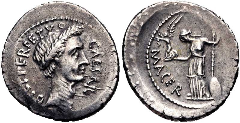 A portrait of Julius Caesar on a denarius. On the reverse side stands Venus Victix holding a winged Victory.