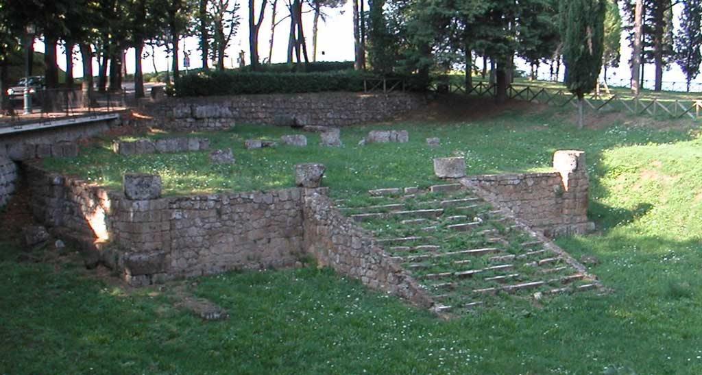 This is a photo of the ruins of the foundation of an Etruscan temple at Orvieto. The central stairway highlights the frontality of the temple that once stood at this site.