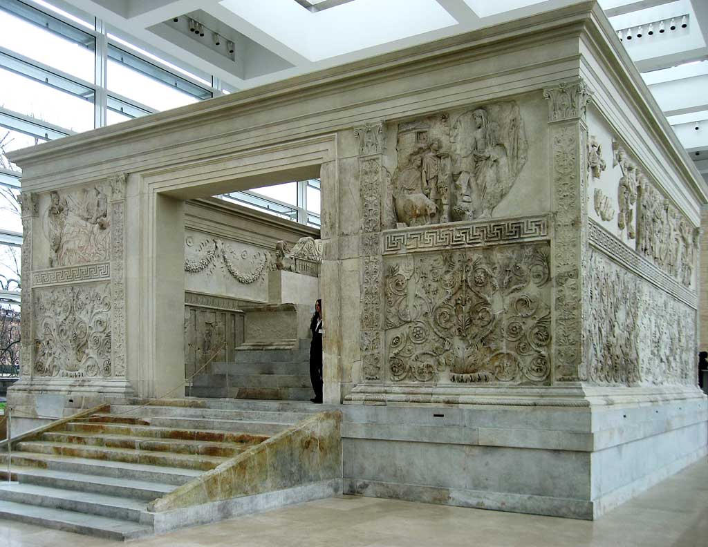 This photo shows the Ara Pacis Augustae. The actual u-shaped altar sits atop a podium inside the square wall that is seen here and demarcates the precinct's sacred space.