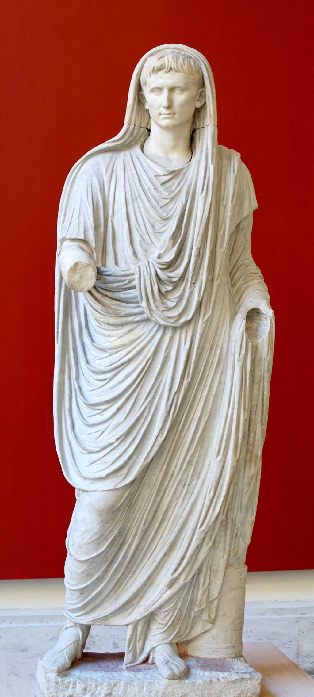 This photo shows a statue of Augustus portrayed as Pontifex Maximus, attired with a toga over his ever-youthful head, an attribute that serves to remind viewers of his own extreme piety to the gods.