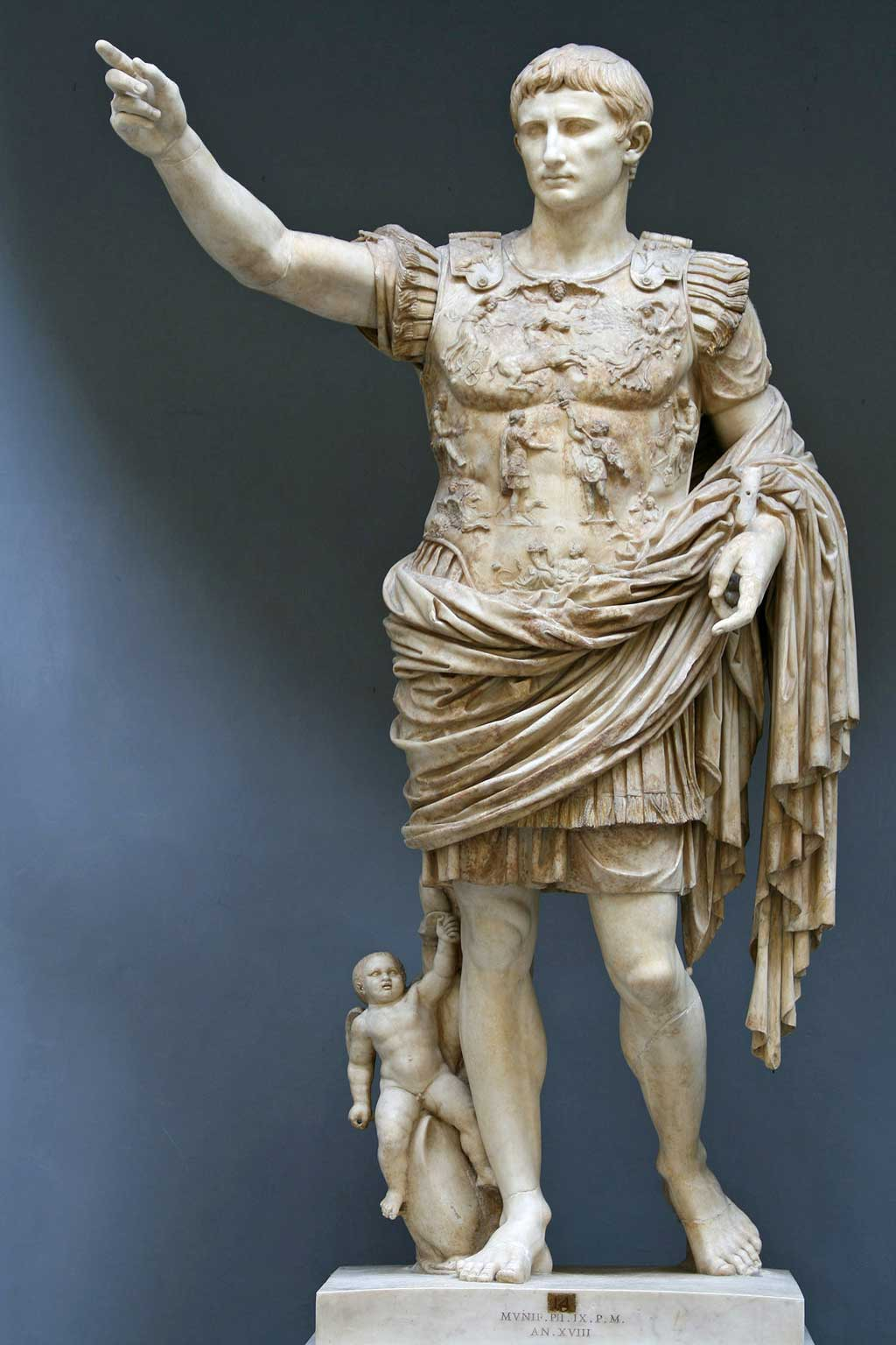 The Augustus of Primaporta statue shows the influence of both Roman and Classical Greek works. Cupid rides a dolphin at Augustus' feet, a symbol of his divine ancestry.