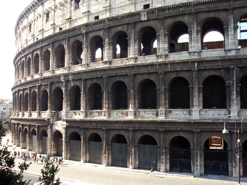 Picture of the outer exterior of the Colosseum with three rows of vaulted arches.