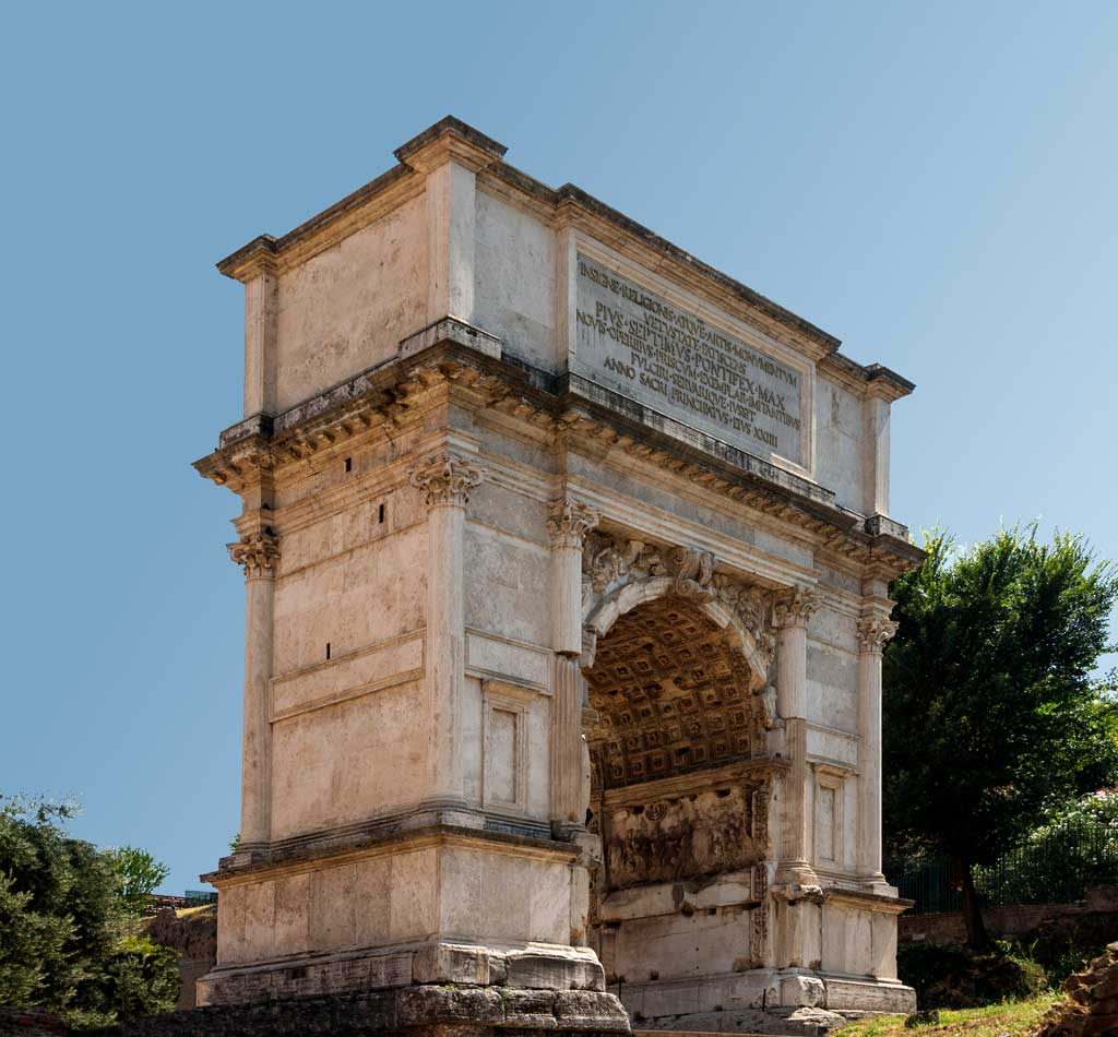 Picture of the Arch of Titus. The Arch is a two-column structure with a large archway within it. Atop the archway is an inscription which indicates that the arch was erected after the death of the emperor.
