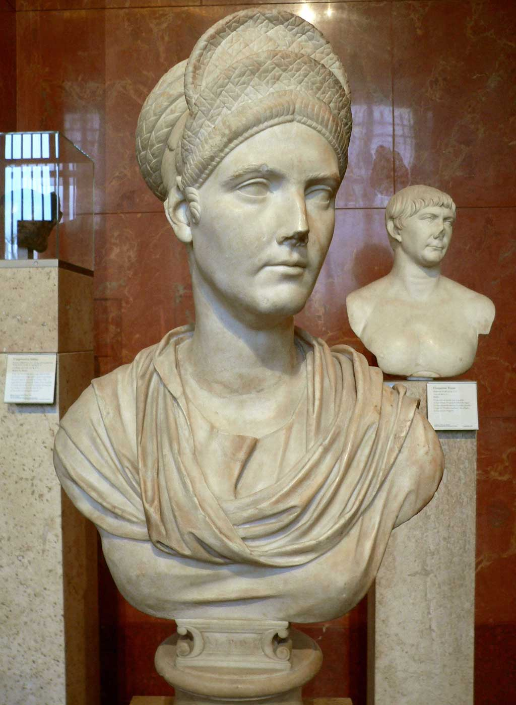 A bust of Trajan's Neice, Matidia. Like the Flavians, Matidia's hair stands in a stack, but unlike the Flavians, her hair stands in flat layers than in curls.