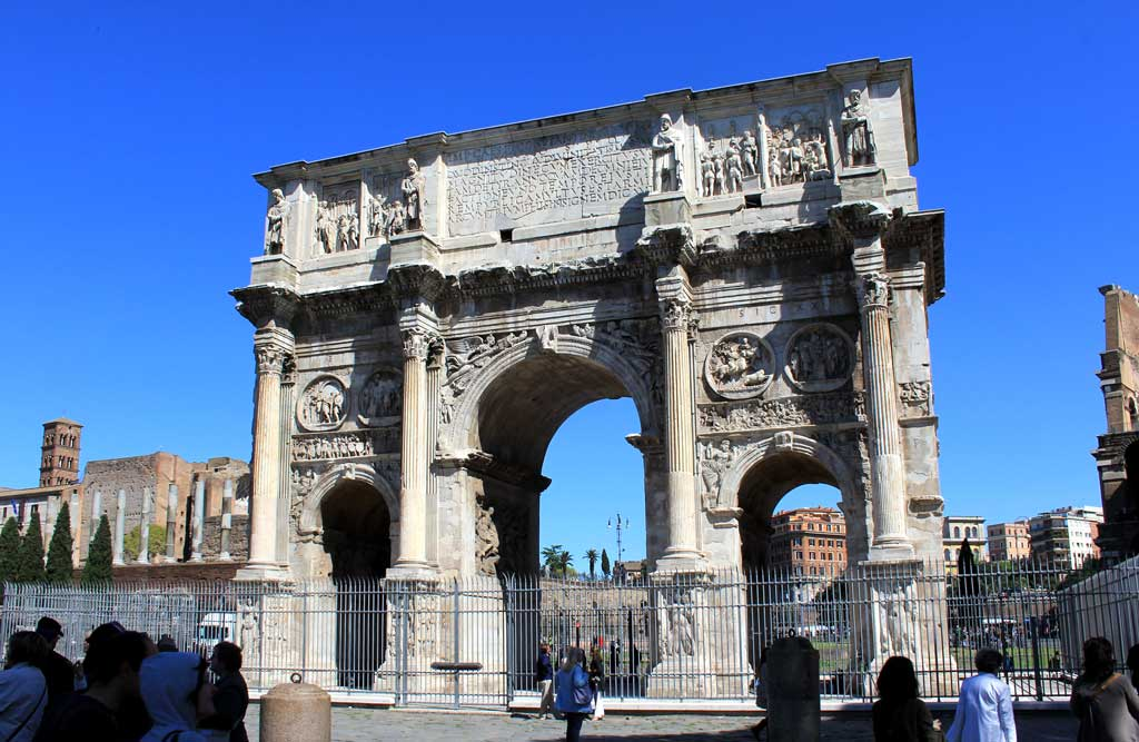 This is a current-day photo of the Arch of Constantine. Unlike Titus' arch, this arch includes three archways with the middle being the largest. Atop the archway in an inscription praising Constantine's rule as emperor.