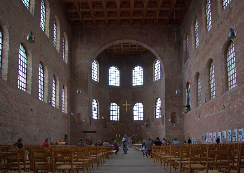 This is a picture inside the Aula Palatina. One sees within a simplified Roman basilica plan, consisting of a wide nave that ends in a north-facing apse.