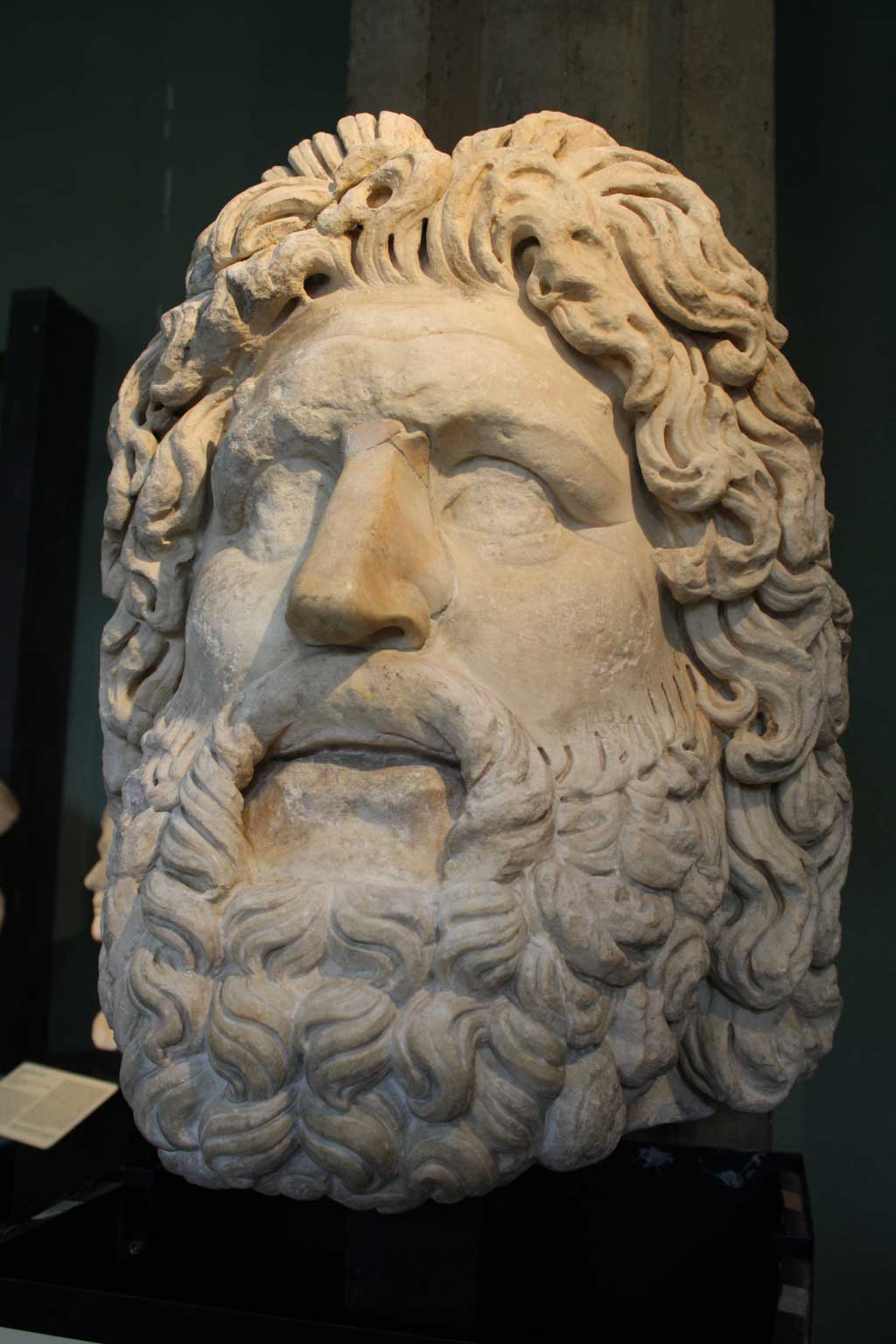 Picture of a marble bust of the bearded Roman god Jupiter
