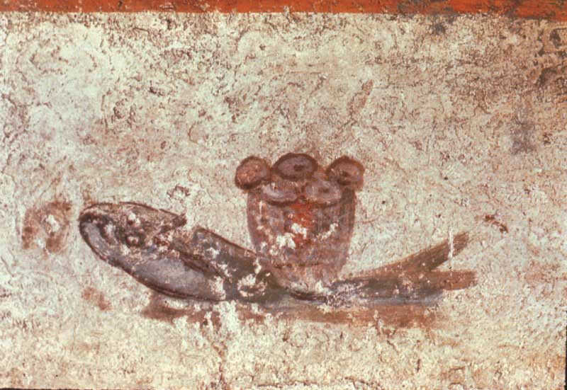 Fresco illustrating a grey-scale fish with loaves of bread a top it.