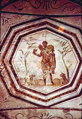 A painting of the The Good Shepherd painting. The shepherd has a lamb rape on his shoulders and lambs sitting around his feet.