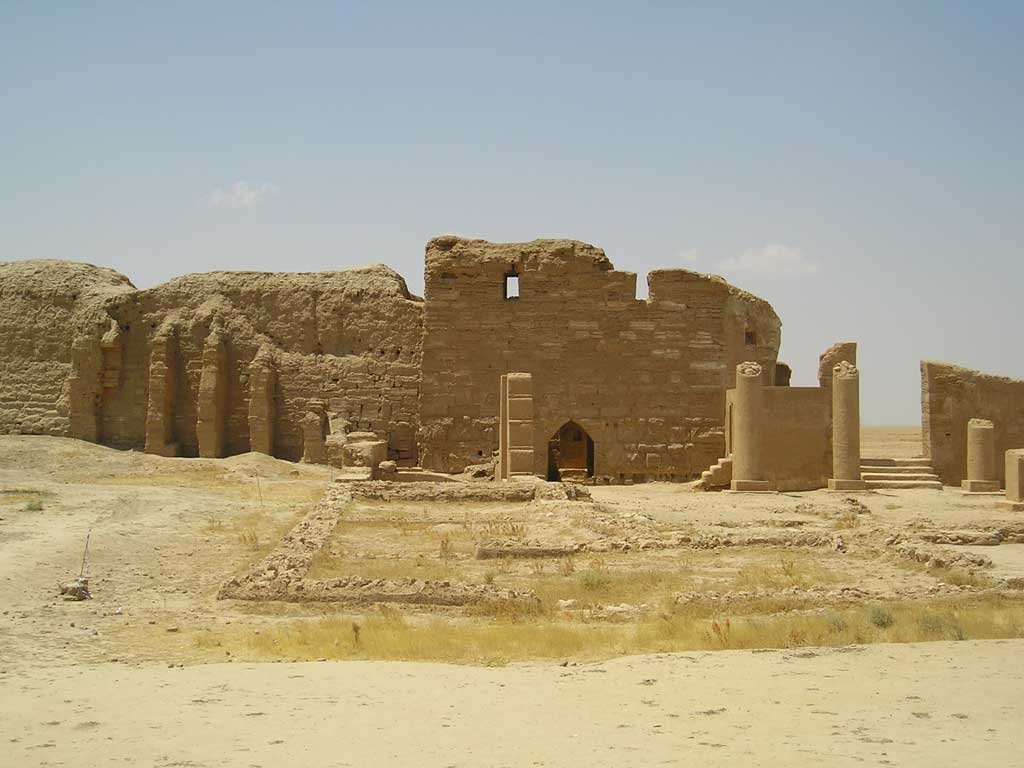 Picture of the remains of House Church at Dura-Europos. What the viewer sees here are partially standing sandstone walls as well as the remains of several rooms situated beyond the remains of the Church's entryway.