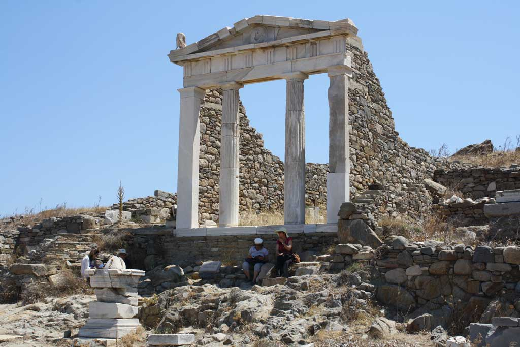 Remains of a temple once dedicated to Isis. The onlooker today sees four marble columns on a raised platform with the stone walls still partially in place.