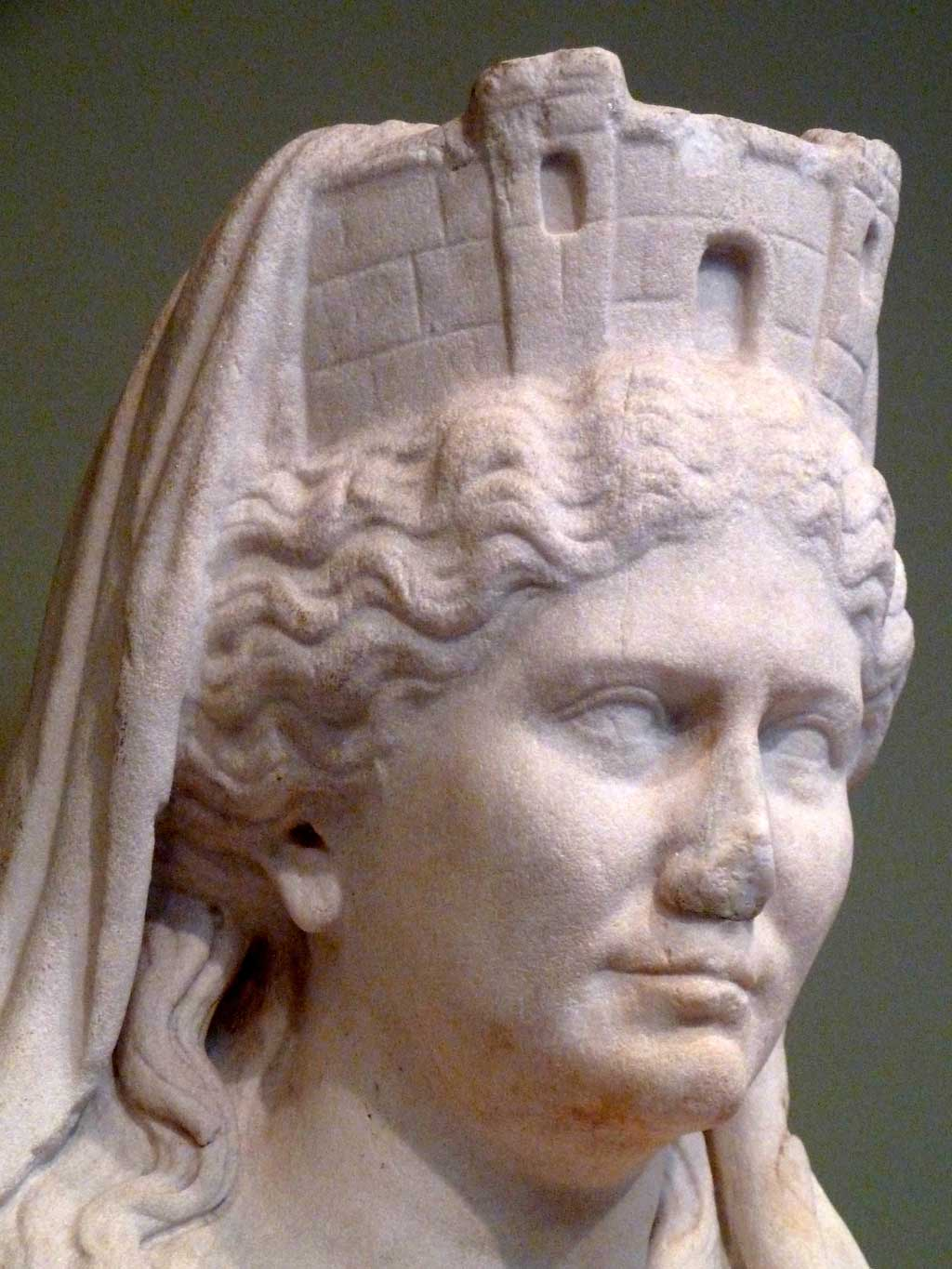 Cybele, the mother goddess, wears a crown in the form of a towered wall, a symbol of her role as protectress of cities, 50 CE, Roman, Getty Villa.