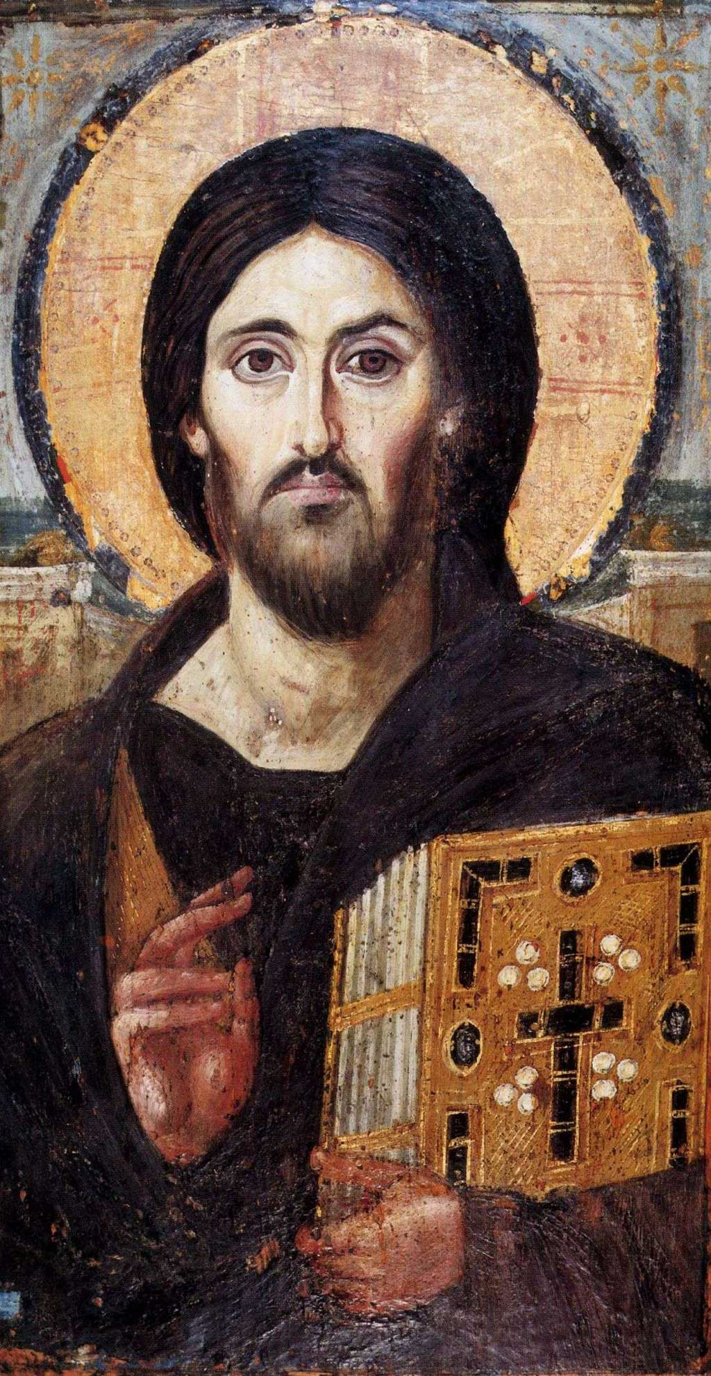 The oldest known icon depicting Jesus Christ (6th century) in Saint Catherine's Monastery, Egypt. In this image, Jesus grasps a New Testament in his left arm while making a symbol for peace with two right fingers. Also notable here is that Jesus eyes are of different color, with his brown iris dominating far more of his left eye than his right eye.