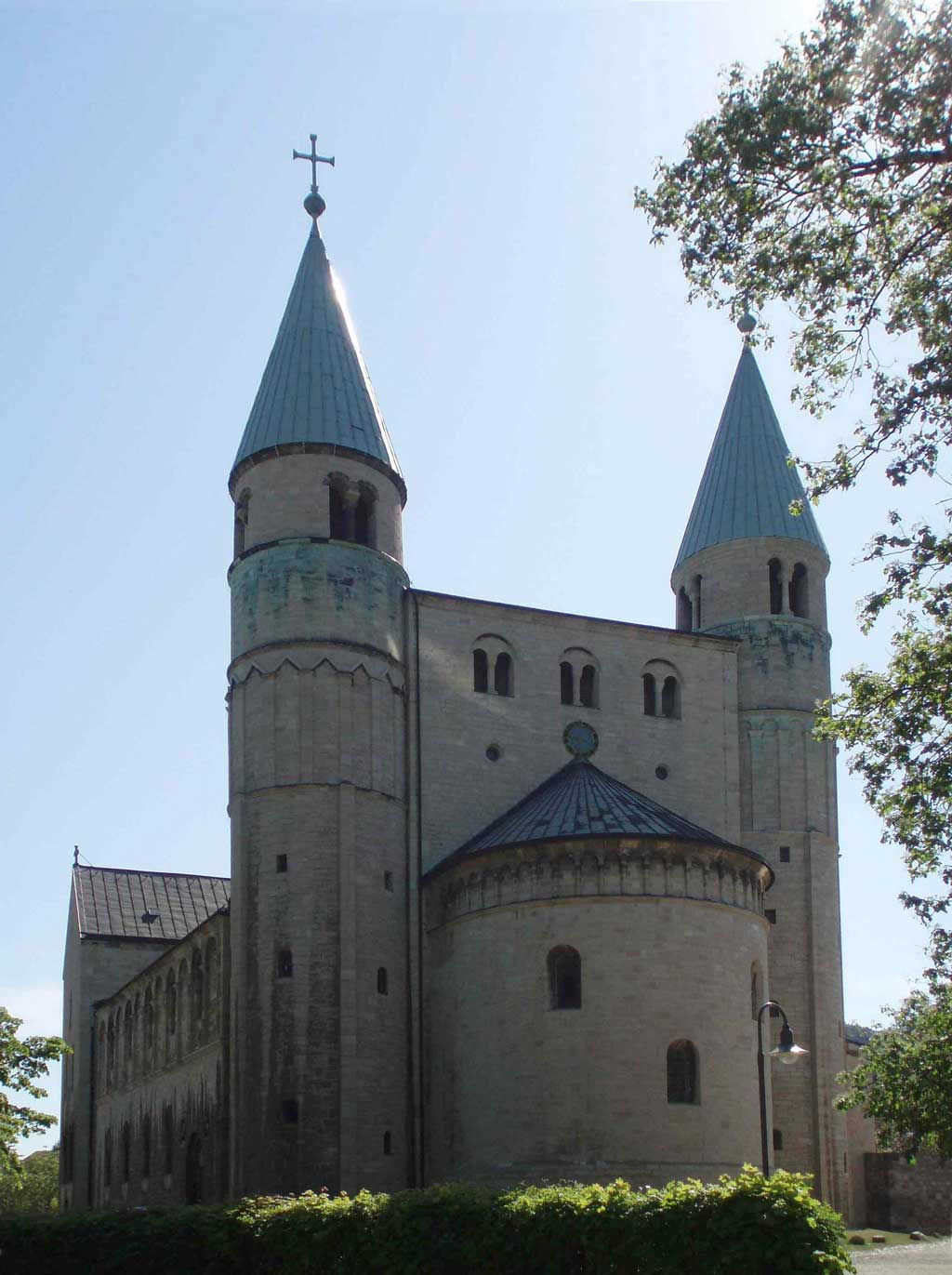 Image of the exterior of St. Cyriakus, Gernrode. From this perspective, the viewer sees the round arcade of the cathedral and the two steeples above it.
