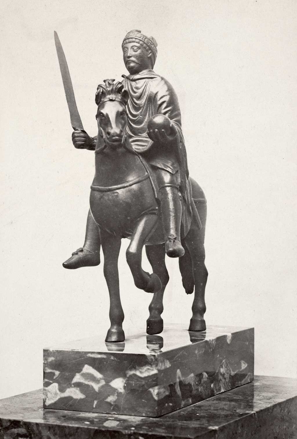 Statue of a Carolingian king, possibly Charlemagne, riding on horseback and carrying a sword in his right hand and a royal orb in his left hand (c. 870)