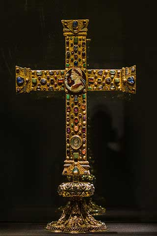 Picture of the Cross of Lothair (c. 1000). The wooden cross is laden in gold and bejeweled in center. The center of the cross has a depiction of the Carolingian ruler Lothair.