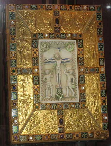 Image of the Codex Aureus of Echternach. The Bible has a gold-plated cover with an illustration of the crucifixion carved in ivory at its very center.